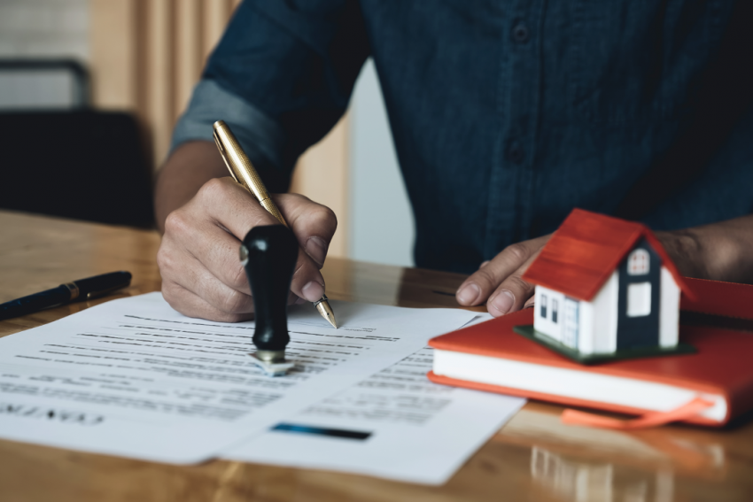 Signing a contract with a home mortgage company in Bloomington, Illinois